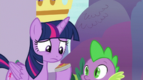 Twilight holding the sun-and-moon amulet S9E13
