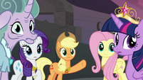 Applejack pointing back at the crater S7E26