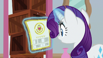 Rarity looks at Friendship University flyer S8E16