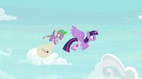 Twilight and Spike fly through the sky S9E5