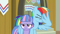 Rainbow smacks her face with her wing S9E6