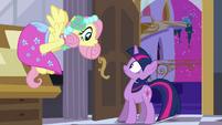 Fluttershy greets Twilight in her dress S2E25