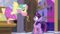 Fluttershy greets Twilight in her dress S2E25