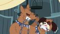 Orthros heads fighting over chain S4E22.png