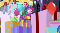 Pinkie Pie kicks side of a large gift box S9E4
