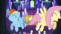 Rainbow and Fluttershy fly through the castle S4E26
