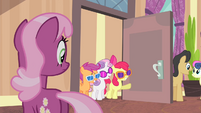 CMC with glasses entering the lobby S4E19