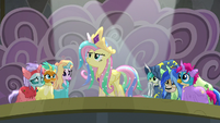 Fluttershy standing confidently on stage S8E7
