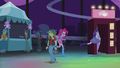 Pinkie and Rarity run into first photo booth EG2.png