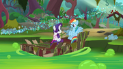 Rainbow and Rarity sitting on the raft S8E17