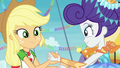 AJ and Rarity hand-in-hand on stage EGROF.png