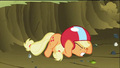 Applejack drops down to the ground for cover from debris created by Rainbow Dash S2E03.png