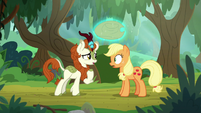 Autumn Blaze levitates Applejack's hat S8E23