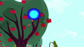Blue sphere of light in an apple tree S5E13.png