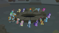 Mane Six and Pillars stand around the Well of Shade S7E26