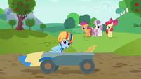 Rainbow Dash coasts past screen in speed cart S6E14
