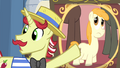 Flam pointing at picture showing a short pony S4E20.png