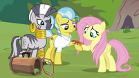 Fluttershy gives the gecko to Dr. Fauna S9E18