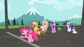 Ponies waiting at finish line with Pinkie pointing S2E7.png
