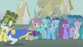 Rarity running away with Golden Harvest in background S1E6.png