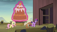 Twilight levitates cake through the McColts' gate S5E23