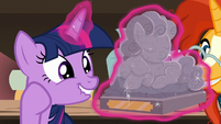 Twilight marveling at antique pony statuette S7E24