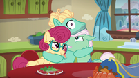 Zephyr Breeze's eyes widen as his hugs his parents S6E11