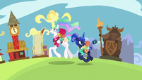 Celestia and Luna passing Appleloosa S9E13