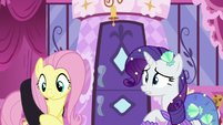 Fluttershy slings the black dress across her back S5E21