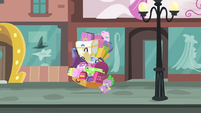 Spike lifting a pile of bags S4E08