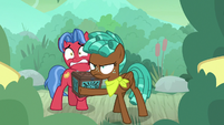 Spur protecting Biscuit from swamp ponies S9E22