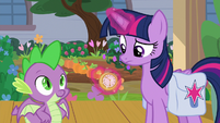 Twilight looking at a pocketwatch S9E5