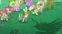Zecora and ponies look at Chrysalis while her shadow appears S5E26