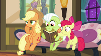 Apple Bloom pointing at yet another photo S3E8