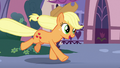 Applejack galloping toward the contest ponies S7E9.png