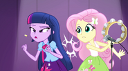 Fluttershy dislodges confetti in Twilight's throat with tambourine EG2