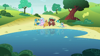 Friendship students sitting by the lake S8E1