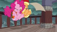 Pinkie Pie and Applejack stumble backward S6E22