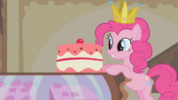 Pinkie Pie standing in front of a cake S1E10