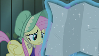 Fluttershy looking at a map of Equestria S7E26
