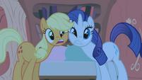 Rarity and Applejack rubbing faces S1E8