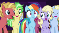 Rainbow Dash pushes through the crowd S8E5