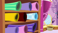 Rolls of fabric at Carousel Boutique S6E6