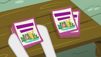 Sweetie Belle sets down stack of day camp flyers S7E21