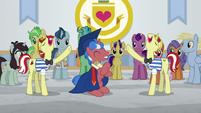 Unicorn stallion in a graduation gown S8E16