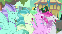 Hippogriffs cheering at the festival S8E6