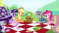 Main cast looking at Maud eating the gem S4E18