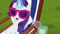 Rarity relaxing on a beach chair S6E14
