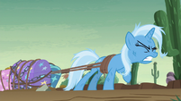 Trixie pulling on her luggage S8E19