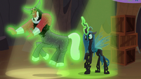 Queen Chrysalis levitates Tirek around S9E8
